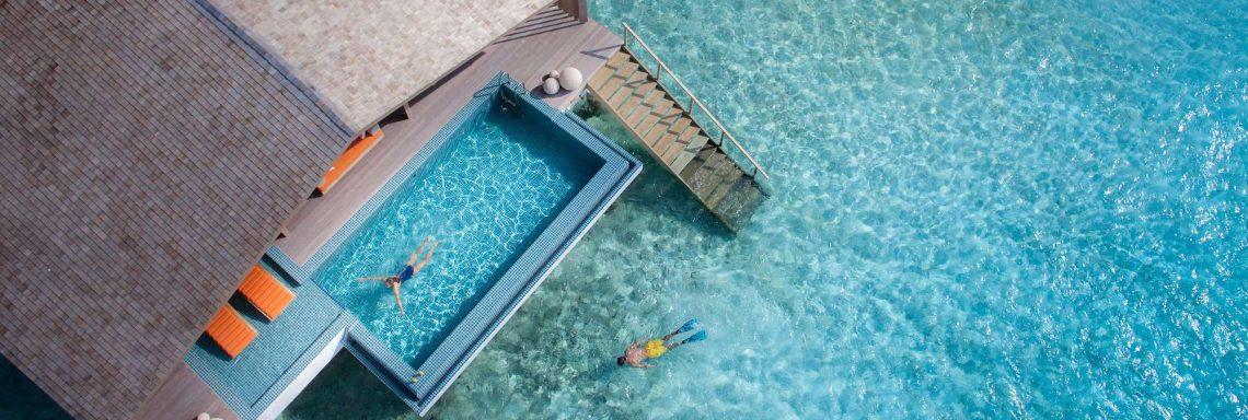 Club Med Villas de FInolhu, aux Maldives - Vue aérienne d'une villa privative sur la lagune bleu turquoise